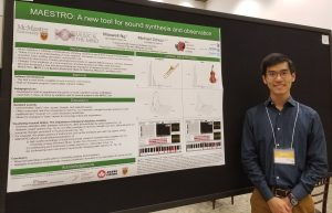Maxwell with his NSERC poster